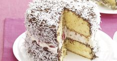 Lamington Cake  --  yellow cake layers, whipped cream with raspberries filling, chocolate frosting, and coconut.