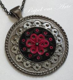 quilled flower inside a pendant