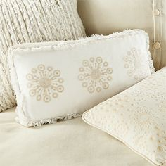a complex mix of tones and textures, the bianca collection is rich in dress-maker details. a duvet with organza covered satin piping. toss pillows wit