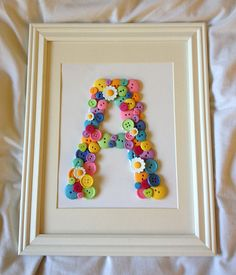DIY Initial Button Art- cute for a baby room