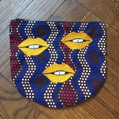 "Lips pouchette Purchased in Paris and never worn! African inspired print with 3 mustard embroidered lips! #muah! 8"" W x 7"" L. Zip closure. Use as an accessory or evening clutch. Bags Clutches & Wristlets"