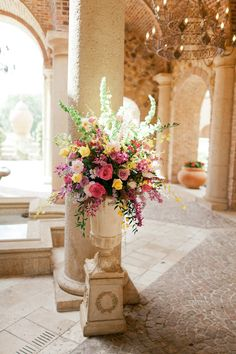 Bella Collina: Mary and Brian. Floral by Lee James Floral Designs. Photo by Andi Mans Photography.