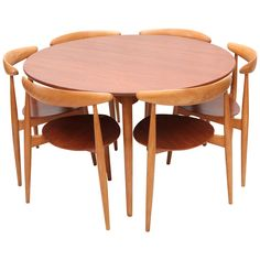 Hans Wegner Three-Leg Table with Matching Three-Leg Chairs | From a unique collection of  THIS IS IN LA  antique and modern dining room sets at https://www.1stdibs.com/furniture/tables/dining-room-sets/