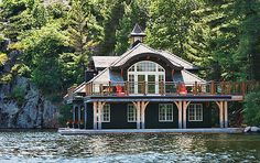 Cottage boat house...I know Rob wants one of these!