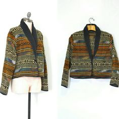 """Vintage Woven Mexican Blanket Jacket Vintage 1980s woven southwest-inspired cropped jacket of woven cotton tapestry with a boxy fit, one button closure and dolman sleeves that narrow ever so slightly at the wrist.  --- M E A S U R E M E N T S --- Fits like: slouchy small / medium Tag Size: medium Length: 21"""" Shoulders: 19"""" Sleeve Length: 25.5"""" Chest: up to 46"""" Hem: 40""""  Brand 