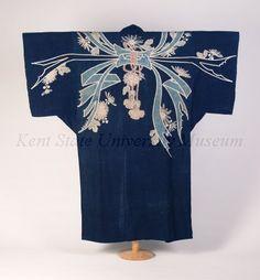 "back view of yogi, L. 19th C., Sleeping coverlet, Yogi, Indigo cotton, tsutsugaki pattern of abalone (noshi) and chrysanthemum (kiku), face only, unquilted. Original catalog card also indicates 1850-1875; Unfinished ""Unpadded Kimono-shaped Futon Cover (Yogi), Japan, late nineteenth century. Nuptial indigo-dyed cotton plain-weave decorated with paste-resist dyeing, 1875-1899. Kent State Museum."
