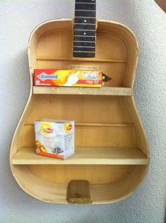 DIY guitar shelf! how cool is this. You can use an old or broken guitar and make something cool AND useful. I am trying this out!