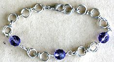 Dog Bone Chain Bracelet (I love this site!! This tutorial was about making your own chain. Very easy instructions and pictures to follow. Beautiful bracelet is the final product but you could make anything with this! Love it!! FMTK)