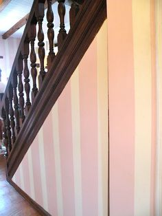 pink and cream striped wall with dark wood~by ::Surroundings:::
