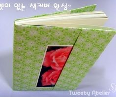 tutorial for origami book cover. Korean instructions don't translate well but visuals are good if you have a bit of origami experience