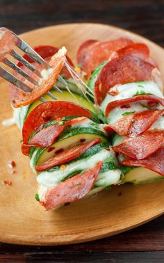 Cheesy Hasselback Zucchini Pizzas - Peas And Crayons - Skip the crust and grab a zucchini! These Cheesy Hasselback Zucchini Pizzas are guaranteed to impre - Low Carb Zucchini Recipes, Zucchini Pizzas, Low Carb Recipes, Diet Recipes, Cooking Recipes, Healthy Recipes, Cooking Fish, Cooking Beets, Zucchini Squash