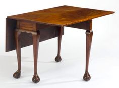 Northeast Auctions - JiII & Mickey Baten Collection.  Aug. 15, 2015. Lot # 523 (open).    Est. $9,000-$15,000.   Sold: $5,700 ($4,750).   Description:   FINE CHIPPENDALE FIGURED-MAHOGANY RECTANGULAR DROP-LEAF DINING TABLE, POSSIBLY DANIEL GODDARD, NEWPORT, RHODE ISLAND, CIRCA 1760, having a hinged rectangular top of highly figured mahogany, molded cyma-scalloped aprons and cabriole legs ending in ball and claw feet. Height 26 ⅞ inches, length 41 ¾ inches, width 11 ¾ inches, top open 41 ¾ x…