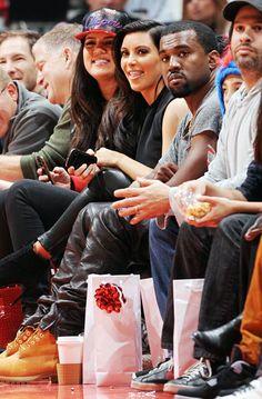 Khloe Kardashian Odom, Kim Kardashian, and Kanye West on December 25, 2012 in Los Angeles, California.