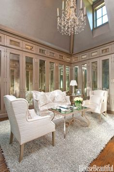 """""""I adore my closet! The mirrored panels and striking hardware were inspired by the Hôtel de Crillon in Paris. I'm a neat freak, so there's a place for everything, and everything is in its place — Manolos in their boxes, sweaters stacked vertically by color."""" —Betty Lou Phillips, Interior Designer"""