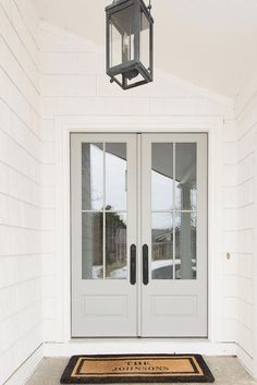 Front Door We changed the exterior color of our home to white shake and replaced our 7 solid wood doors with 8 french doors adorned with big windows that lets the morning light pour into our home - April 13 2019 at Grey Front Doors, Beautiful Front Doors, Front French Doors, Exterior French Doors, White Front Doors, Exterior Paint, Front Door Entry, Home Depot Front Door, Farmhouse Front Doors
