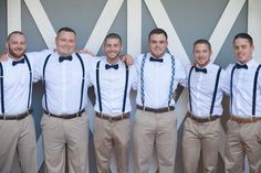Groom and Groomsmen with Navy Suspenders and Bowties - Rustic Navy and Yellow Wedding at Swor Cottage in Central Florida - Photo: Casie Marie Photography - Click pin for more photos www.orangeblossombride.com