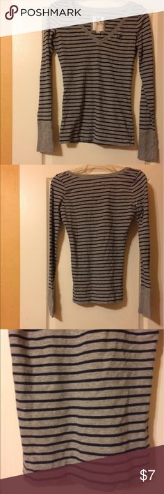 """Women's Gilly Hicks Long Sleeve Vneck Tshirt Small Women's Gilly Hicks basic Gray Blue stripe Long Sleeve V-neck T-shirt with small """"GH"""" on the front. Size Small. 100% Cotton. Machine Wash, Tumble Dry Low.  Nice pre-owned condition.  Inquire for measurements.  Don't forget to bundle and save!  I have tons of gently used and brand new designer clothes and more!  I am listing new items daily and am getting in boutique items as well as more variety of sizes as right now the sizes are what fits…"""