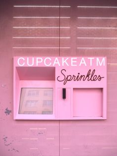 pretty pink cupcake atm in new york, sprinkles cupcakes, so so so cool! kitsch fun cute neon cool
