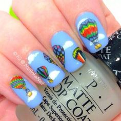 Hot Air Balloon Nail Art...ahhhhh how perfect. Couldn't make it myself though. I even know the different makes of balloons the artist was trying to do.