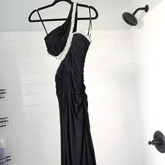 Black prom gown with side slit and side cutout Absolutely beautiful and yet sexy gown that's perfect for prom or any other special events! Very flattering on the body. Has a side slit up one leg. I'm 5'3 and this dress was just touching the floor with 5 inch heels. You could always get it hemmed. I got many compliments on this. Worn once. Only selling through 🅿️🅿️ La Femme Dresses Maxi