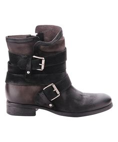 This bold boot features chic leather construction to create a standout finish for your ensemble.