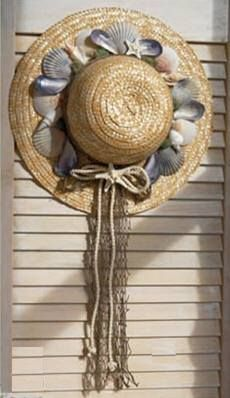 Take an old straw hat, add some shells and ribbon and hang indoors or out!