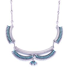 """Boho Beauty Sleep Necklace Native American Zuni Sleeping Beauty turquoise necklace. This necklace was hand crafted by Zuni  artist Octavious  and Irma Seowtewa (signed). It measured 18 1/2"""" long. It is comprised of open oblong silver links with three curved pieces along the center."""