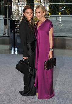 Mary-Kate Olsen embraces the dark side with new brunette hair at the CFDA Awards while Ashley works a silky purple maxi