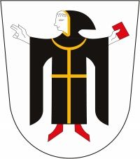 This is the coat of arms of Munich (or Munchen) Germany. It features a a young monk, dressed in black and holding a red book, on a white shield. It derives from the city's seal from 1239 AD, and symbolizes the fact that the name Munchen means