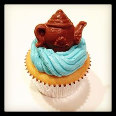 Tea party cupcakes with a chocolate teapot on top!