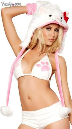 White Kitty Faux Fur Hood - White, faux fur, kitty cat hood with attached ears, eyes, nose, mini red bow, pom pom ties and stay put back strap.