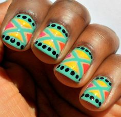 turquoise, yellow, black, orange, and pink tribal-inspired manicure