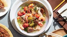 Gulf Coast Seafood Stew - February 2016 Recipes - Southern Living - Hurricane Katrina and a subsequent oil spill off the coast of Louisiana renewed appreciation for our region's seafood. This stew shows off its incomparable flavors, colors, and beauty.   Recipe: Gulf Coast Seafood Stew