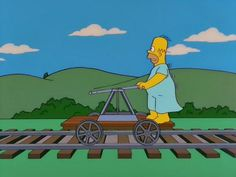 Homer riding a handcar