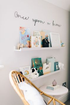 Ikea Painted Picture Ledges With Childrens Books In A Nursery With Once Upon A Tme Sign - Image By Adam Crohill. Pale Grey, Neutral Nursery With Subtle Blush, Blue And Mustard Accents