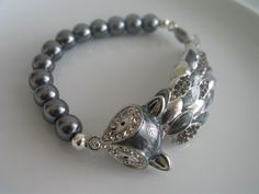 Hey, I found this really awesome Etsy listing at https://www.etsy.com/listing/226744916/unique-silver-tone-clear-bejeweled-fox