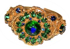 Huge Unsigned Vintage 1960s Peacock Eye Bracelet ~ R C Larner Buttons at eBay  http://stores.ebay.com/RC-LARNER-BUTTONS