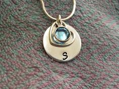 Silver disc personalised with owners first initial, their Swarovski crystal birthstone (June aquamarine) and open heart Thank You Teacher Gifts, Washer Necklace, Pendant Necklace, Hand Stamped, Birthstones, Swarovski Crystals, Initials, Unique Gifts, June