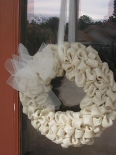 Easy DIY Burlap Wreath Tutorial--needs a different bow or decorations