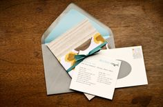 love this invitation set with the fabric wrap and ribbon.