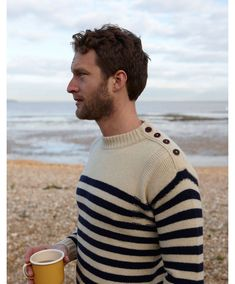 don't like the sweater really, but the stockinette and purl comb with the stripes and button tab is fascinating
