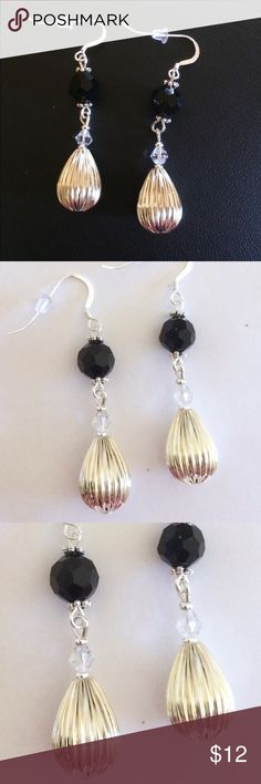 Black and silver dangle earrings These are made with 925 Sterling silver ear wires and plastic earring stoppers. They hang 1 1/2 inches. Beautiful facetted black glass beads and silver plated beads with a clear Swarovski crystal to top it off. Handmade by me Jewelry Earrings