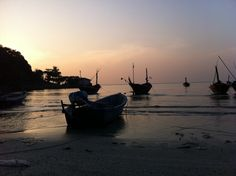 boats in the sunset at rayong, thailand