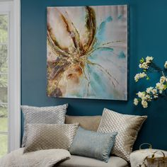 Bold hues of blue and gold make our Turquoise Abstract Floral Canvas Art Print a great addition to your home. Painted on a silver canvas and embellished with metallic sparkle, it catches the light of the room and reflects your style perfectly!