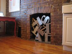 solution to a non-working fireplace: old letterforms