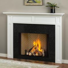 This fireplace mantel is handcrafted in Poplar wood. This mantel s offered with a quality white paint finish. This fireplace mantel iseasy-to-installand requires limited skill and tools. Includes mounting board wood screws and step-by-step instructions. Wood Fireplace Surrounds, Wood Fireplace Mantel, Fireplace Shelves, Wood Mantels, White Fireplace, Farmhouse Fireplace, Fireplace Remodel, Fireplace Inserts, Fireplace Design