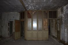 COPYRIGHT - Shannon L. Christie  Save The Petrie Building  15 Wyndham Street North, Guelph, Ontario - Second Floor facing away from the front windows, took this in complete darkness, sorry about the flash in the window. The doorway to the far left was a vault room, the panelled wall was the outer wall of Mr. Petrie's office and the doorway on the far right, is a hallway that leads to a foyer with access to the third floor.