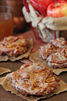 Apple Cider Fritters.... so tender on the inside, crisp on the outside, dripping with apple cider glaze and bursting with caramelized apples.   | From SugarHero.com