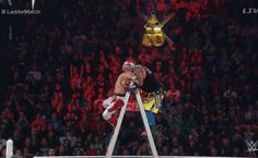WWE TLC Kalisto performs Salida del Sol on a Uso while on top of a ladder and on to a another ladder