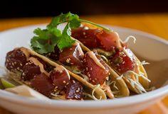 The marinated yellowfin tuna poke taco with avocado and sesame Sriracha mayo